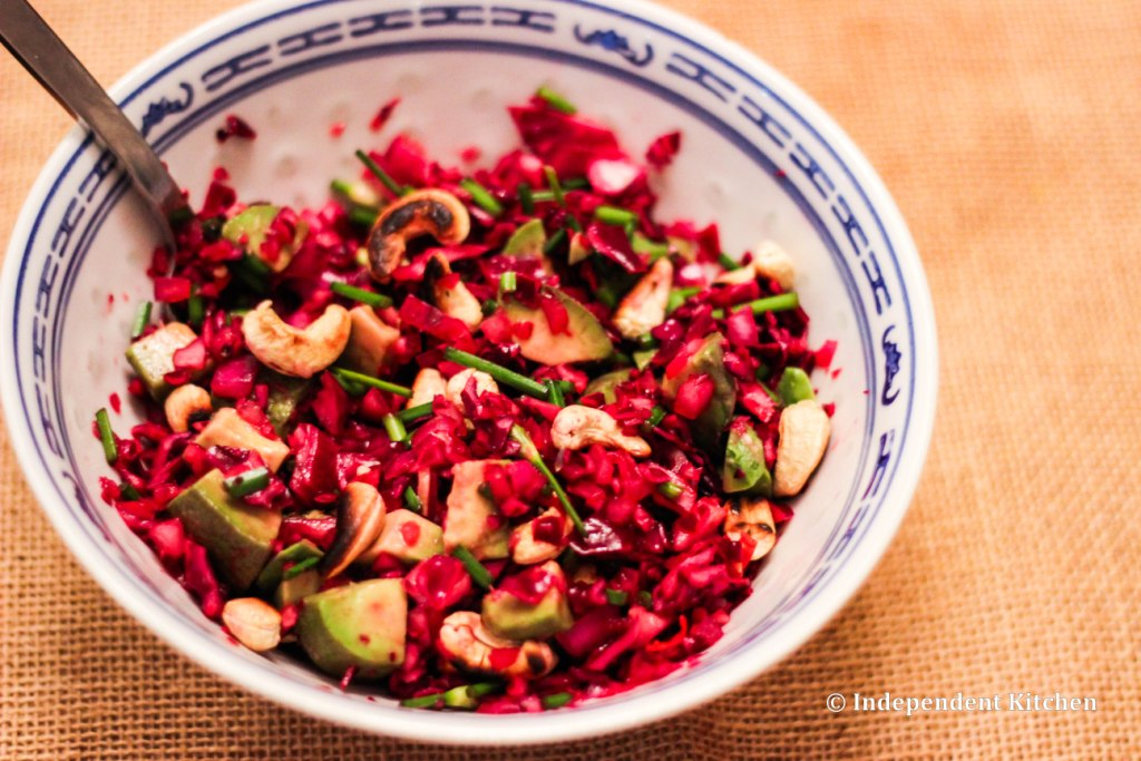 Asian spicy red cabbage coleslaw with avocado, cashews and chives