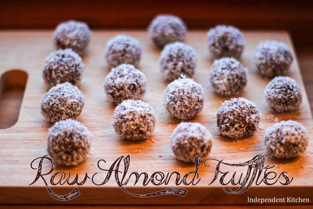 Raw almond butter truffles with dates and coconut